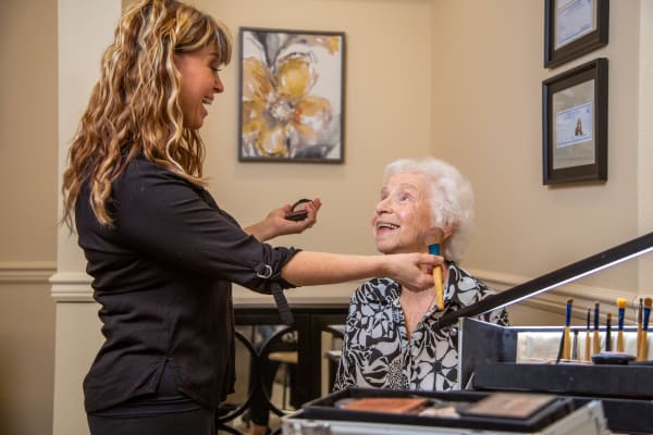 Resident having makeup done at the Salon inside Kennedy Meadows Gracious Retirement Living in North Billerica, Massachusetts