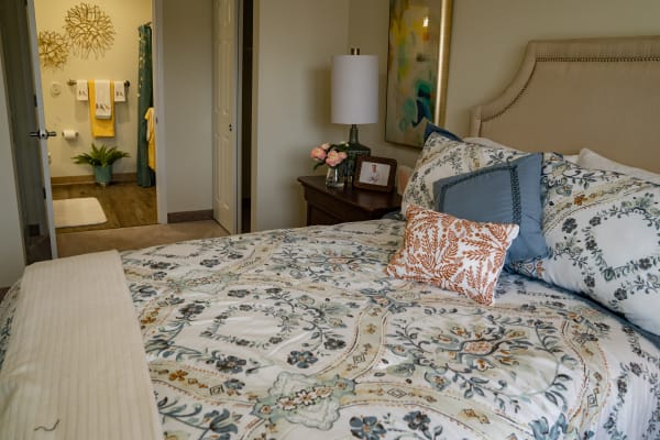 A bedroom at Kennedy Meadows Gracious Retirement Living in North Billerica, Massachusetts