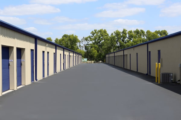 Storage units with purple doors at Midgard Self Storage in Naples, Florida