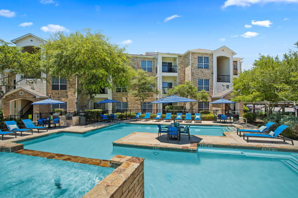 Outdoor community pool at Stoneybrook Apartments & Townhomes in San Antonio, Texas
