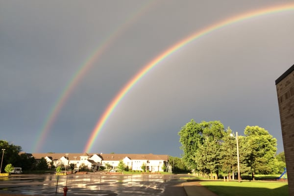 Double rainbow over Deephaven Woods in Deephaven, Minnesota
