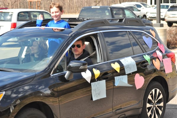 Resident in a car thats covered in decorations at an event for Deephaven Woods in Deephaven, Minnesota