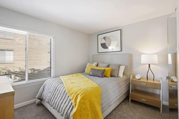 Bedroom and walk-in closet at Washington Apartments in Washington