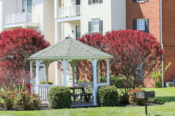 Gazebo with table to sit at and beautiful trees surrounding it at The Preserve at Beckett Ridge Apartments & Townhomes in West Chester, Ohio