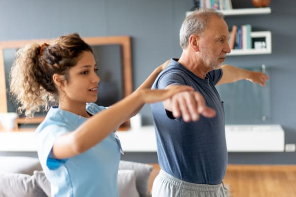 Resident working with a physical trainer at The Sanctuary at Brooklyn Center in Brooklyn Center, Minnesota