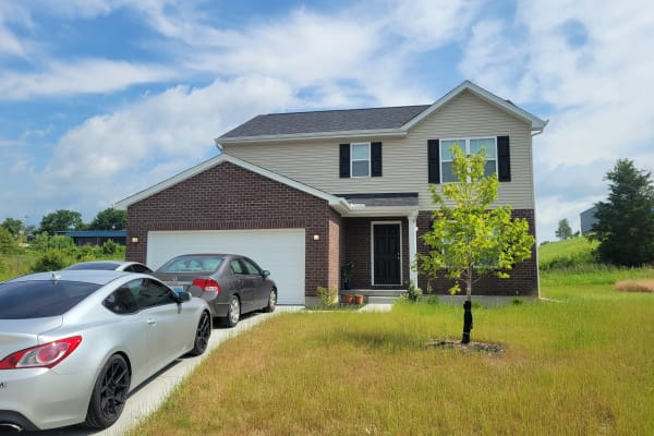 2-car garage and a long driveway on a two-story home in Ft. Wright