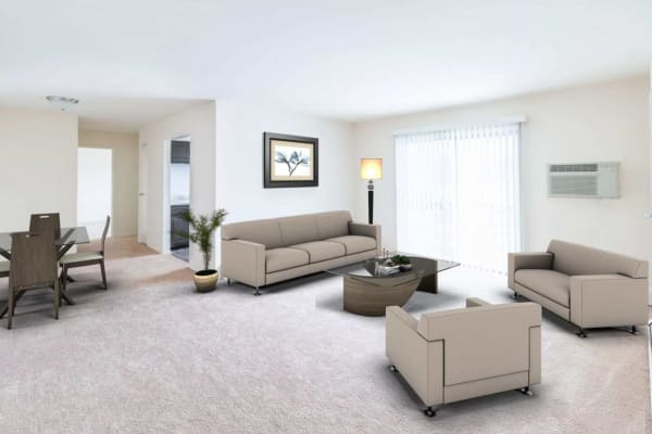 Spacious living room and dining area in a model apartment home at Washington Gardens in Washington, New Jersey