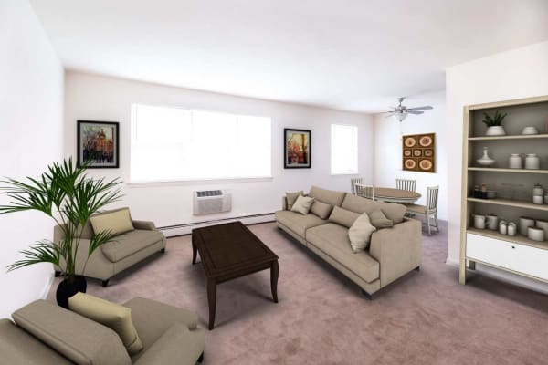 Spacious living room and dining area with plush carpeting in a model apartment home at Scudder Falls in Ewing, New Jersey