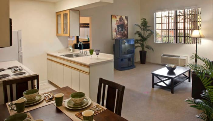 Kitchen and living area of a senior living apartment at