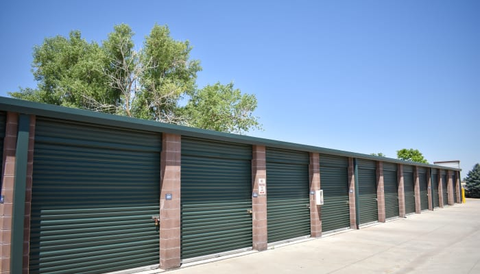 Forest green doors on storage units at a STOR-N-LOCK Self Storage location