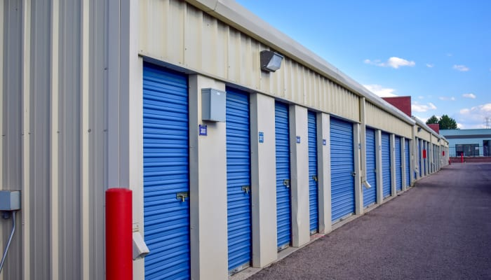 Blue storage units doors in a variety of sizes at a STOR-N-LOCK Self Storage location