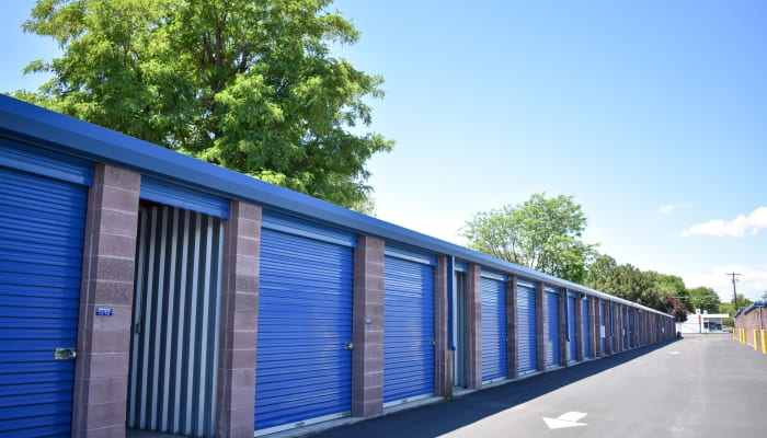 Blue storage unit doors with one shown open at a STOR-N-LOCK Self Storage location