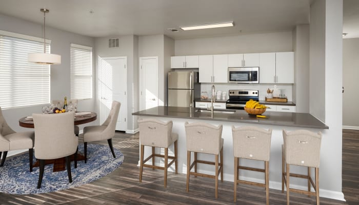 White spec kitchen cabinetry with stainless steel appliances and kitchen island at The Rail at Inverness in Englewood