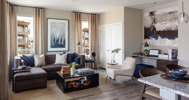 Well decorated model living room at FalconView in Colorado Springs, Colorado