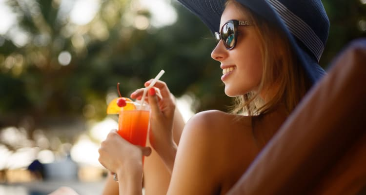 Resident lounging by the pool at Tavalo at Cadence in Mesa, Arizona