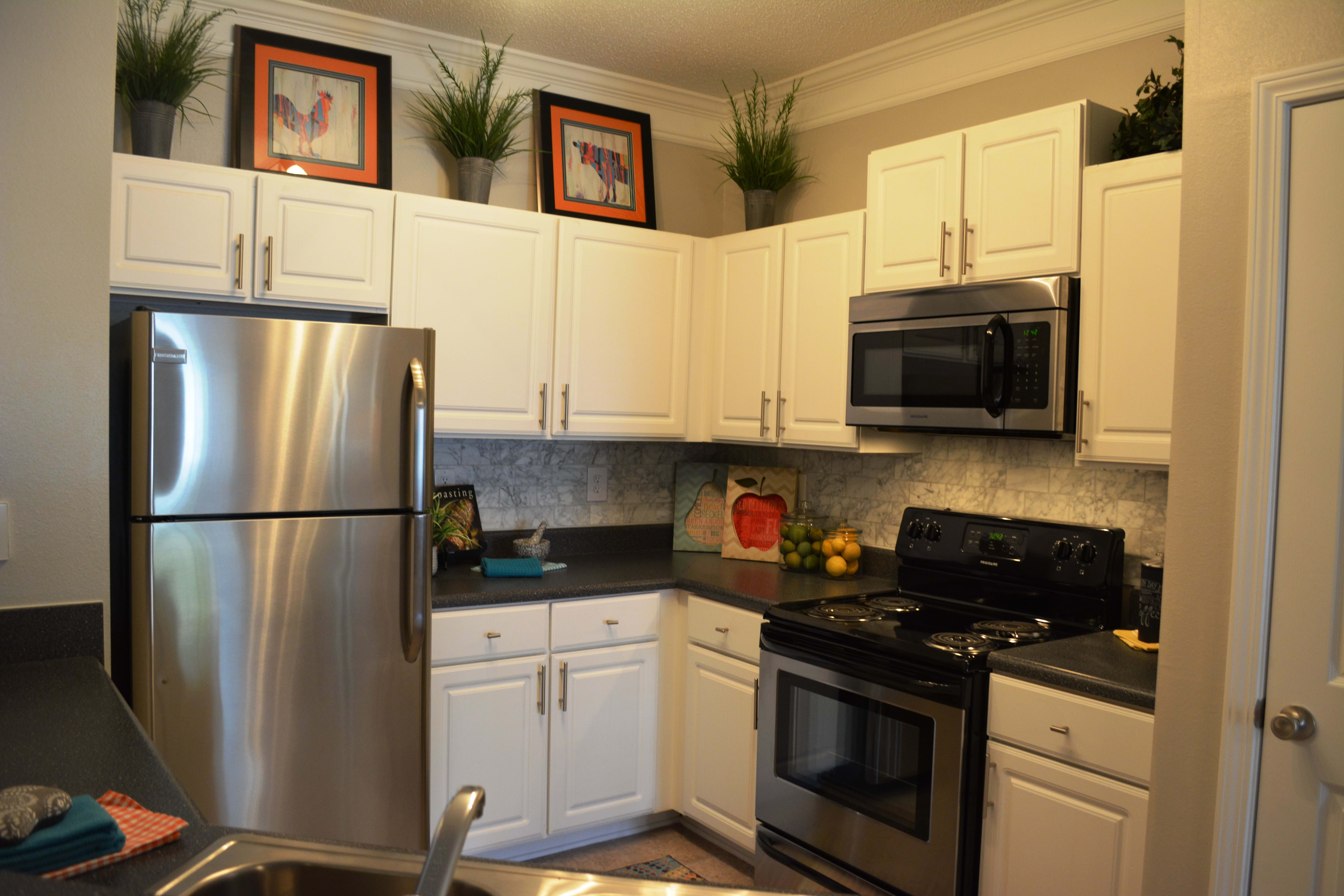 Modern kitchen at The Abbey at Eagles Landing apartments in Stockbridge
