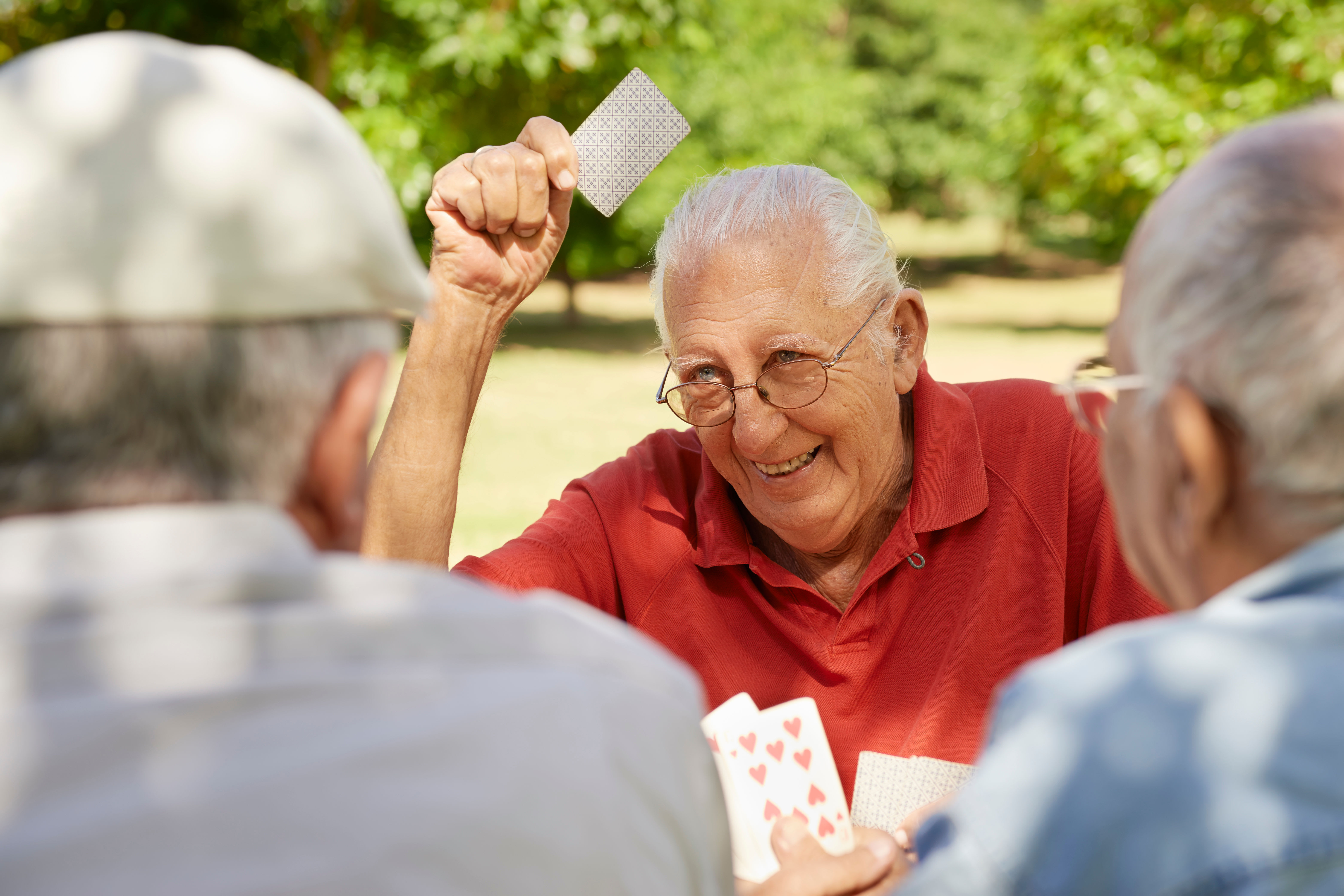Residents playing a card game at The Iris Senior Living in Great Falls, Montana