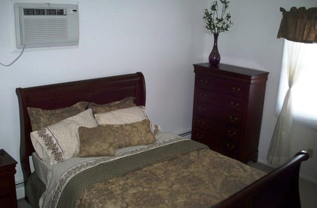 Harborside Manor offers a naturally well-lit bedroom in Liverpool, NY