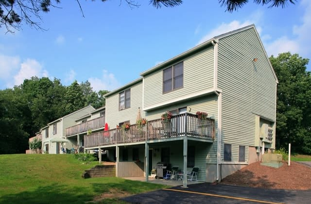 Sturbridge Meadows offers a parking area near the apartments in Sturbridge, MA
