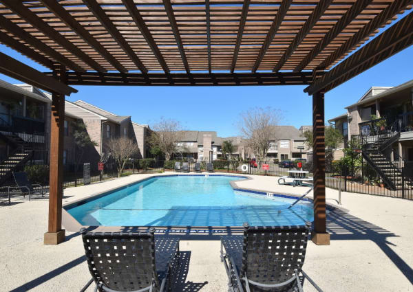 Green Meadows Apartments has pool-side chairs