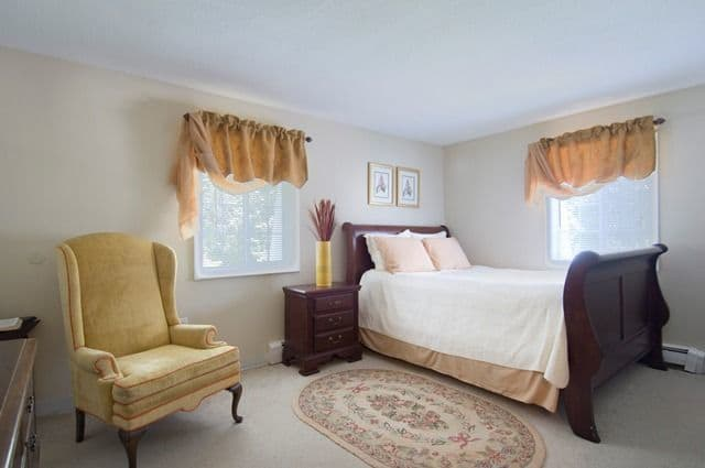 Talbot Woods Apartments offers a naturally well-lit bedroom in Middleboro, MA