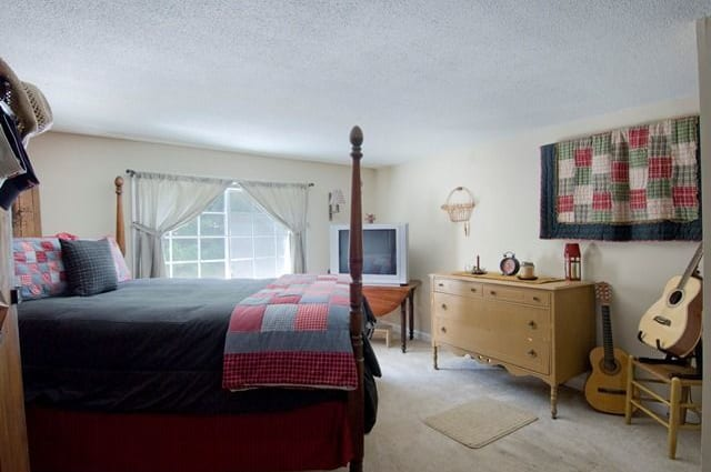 Naturally well-lit bedroom at Talbot Woods Apartments in Middleboro, MA