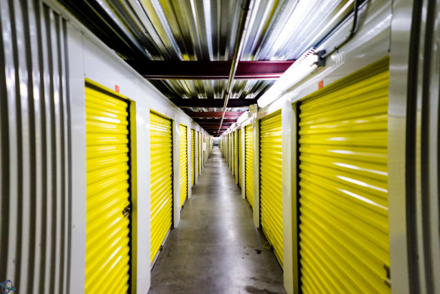 A hallway of yellow storage units at Yellow Door Storage in Argyle, Texas