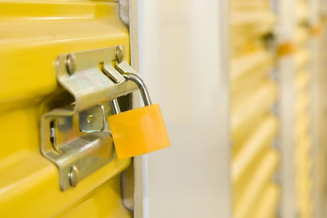 Self Storage containers with yellow doors and locks at Yellow Door Storage in Argyle, Texas