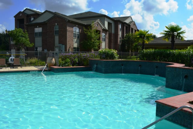 Modern swimming pool at The Abbey at Barker Cypress in Houston, TX