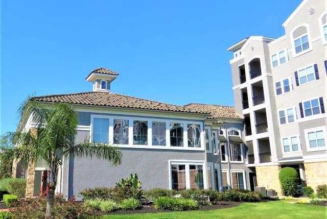 exterior of apartments at The Abbey on Lake Wyndemere in The Woodlands, TX
