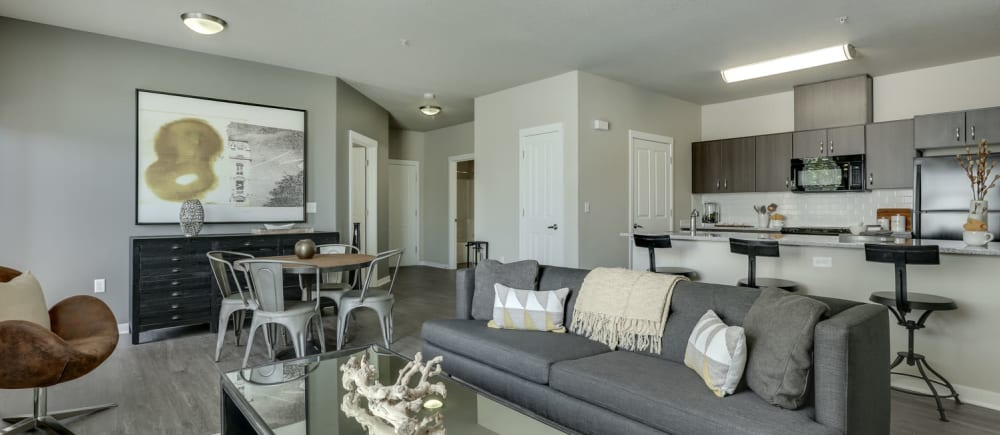 Open concept apartments, living room and kitchen view at Terrene at the Grove in Wilsonville, Oregon