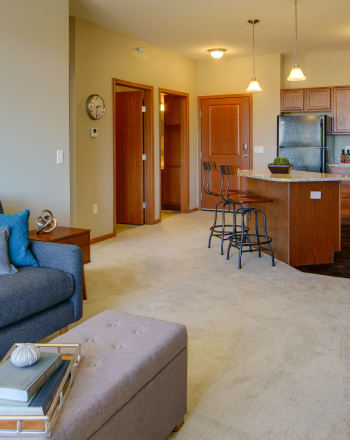 Living room area at Remington Cove Apartments in Apple Valley