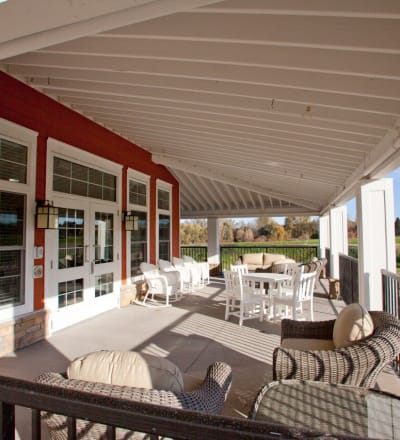 Covered outdoor seating at Keystone Place at LaValle Fields in Hugo, Minnesota
