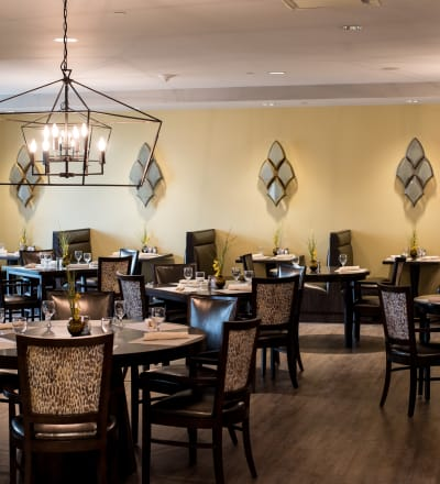 Tables set in the dining room at Keystone Place at Naples Preserve in Naples, Florida