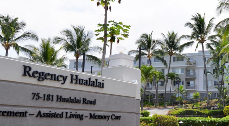 A shot of the front sign and exterior of Regency at Hualalai.
