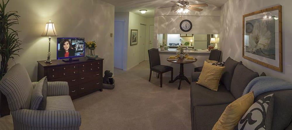 Furnished living room inside of a Waltonwood Carriage Park floor plan
