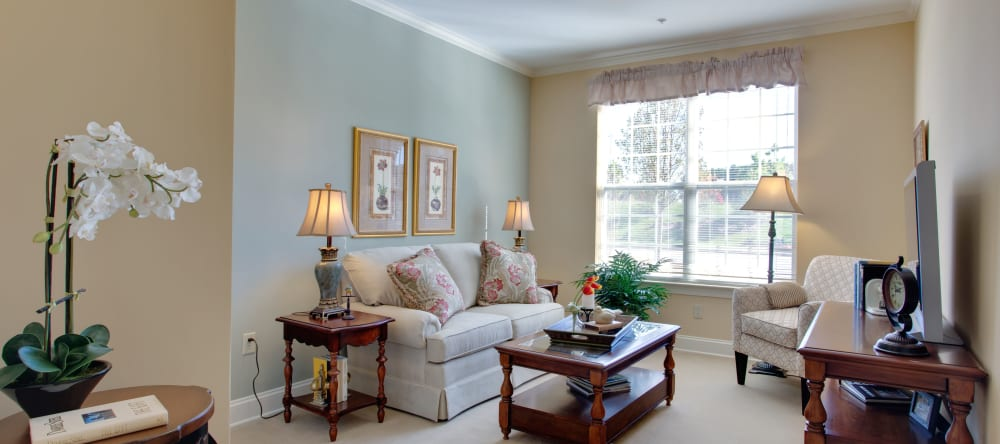 Well lit living space at Waltonwood Cary Parkway