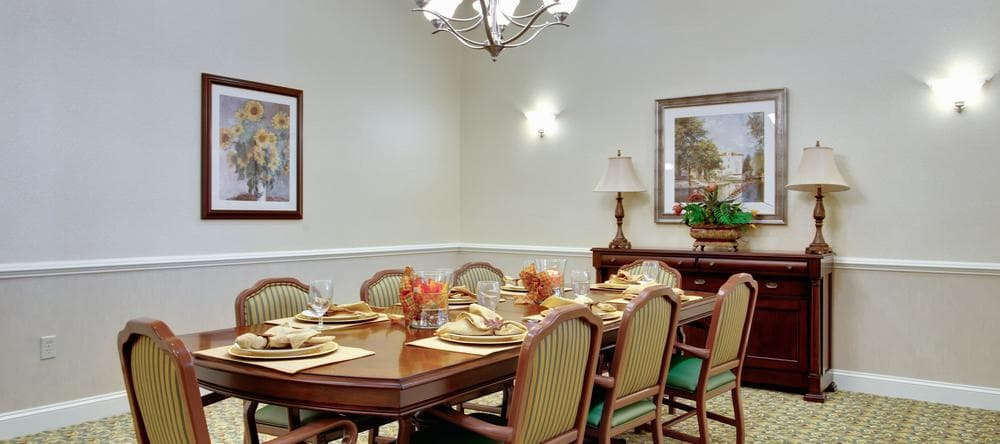 Family dining table for residents with guests at Waltonwood Cary Parkway