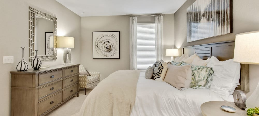 Nice well lit bedroom in a decorate model home at Steele Creek in Jacksonville, Florida
