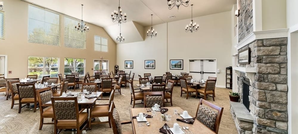 Elegant and inviting dining room with chandeliers at The Springs at Grand Park in Billings, Montana