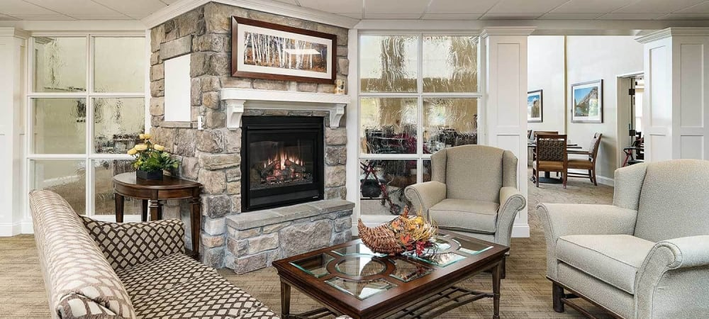 Beautiful lounge with fireplace at The Springs at Grand Park in Billings, Montana