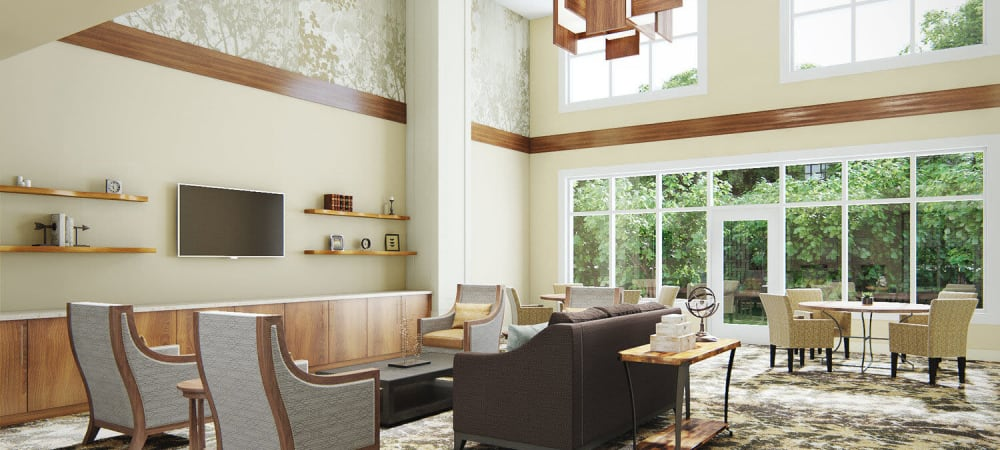 Brightly lit common sitting room in upscale senior living facility with large armchairs, window views, and elegant wood accents at The Springs at Sherwood in Sherwood, Oregon