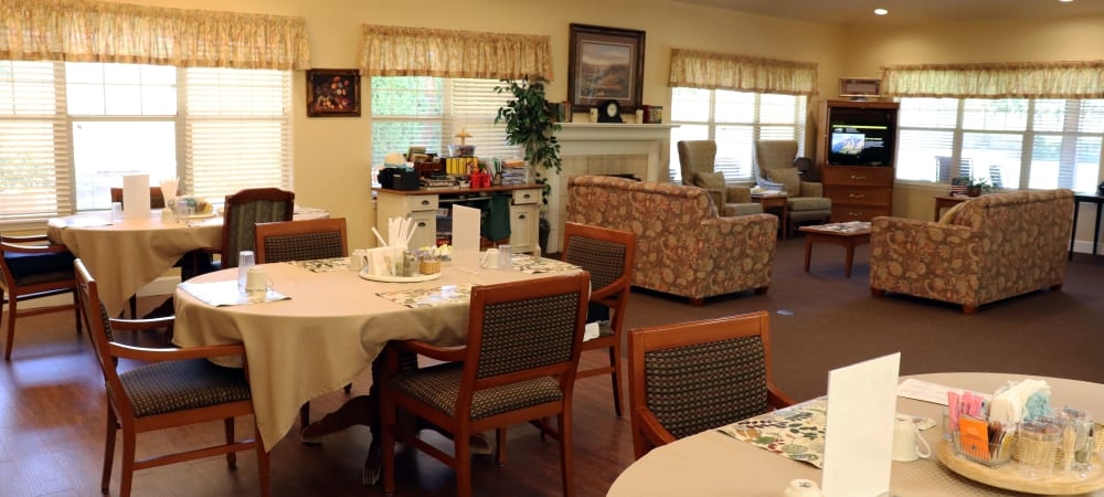 Cheerful dining area with wood accents in upscale senior living facility at The Springs at Willowcreek in Salem, Oregon