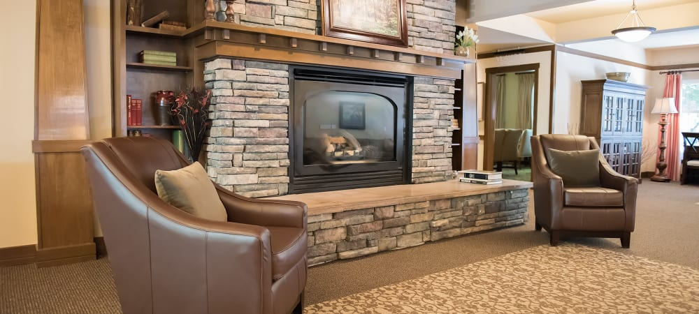 Comfortable sitting area next to a fireplace at The Springs at Wilsonville in Wilsonville, Oregon