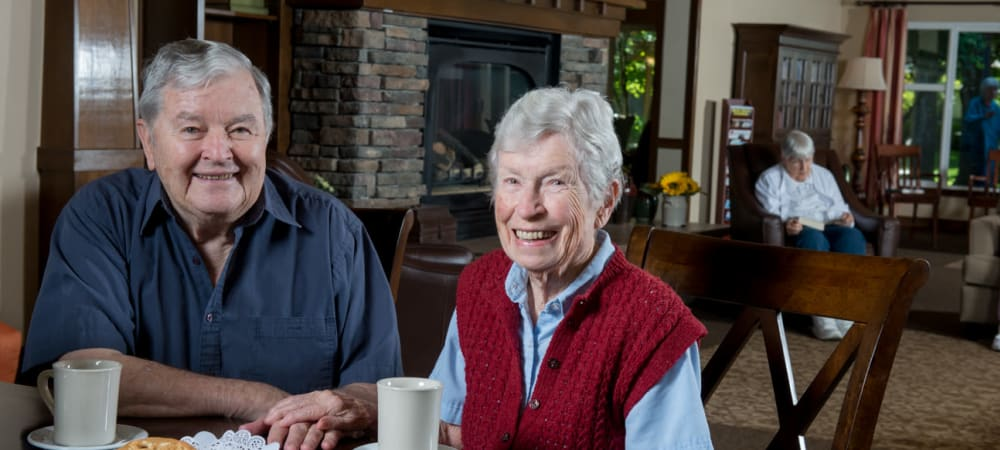 Two residents enjoying a plate of cookies and milk at The Springs at Wilsonville in Wilsonville, Oregon