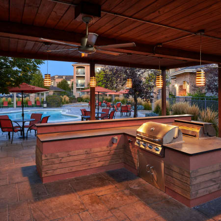 covered outdoor poolside BBQ Area at Hawthorne Hill Apartments in Thornton