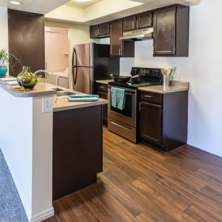 Renovated Kitchen and Dining area at Shadowbrook Apartments in West Valley City