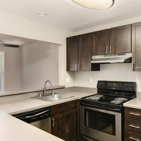 brown renovated Kitchen area at Meadows at Cascade Park Apartments in Vancouver