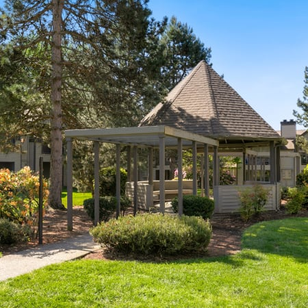 Exterior view of gazebo onsite with lush landscaping of Meadows at Cascade Park Apartments in Vancouver