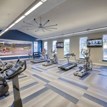 interior newly renovated fitness center with large fan, cardio machines, and boxing machine  at Bear Valley Park in Denver, Colorado